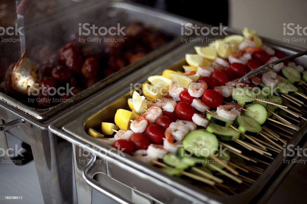 Chafing dish with skewers and meatballs stock photo