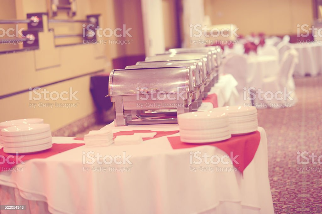 Chafing dishes set for a upcoming ceremony stock photo