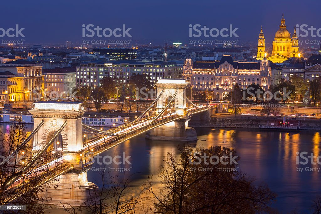 Chain Bridge and St Stephen's Basilica in Budapest at dusk stock photo