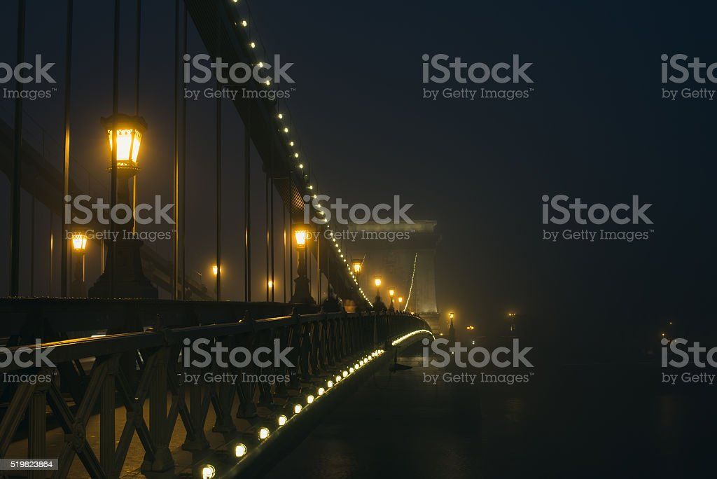Chain Bridge in Budapest, Hungary, the fog, evening lights stock photo