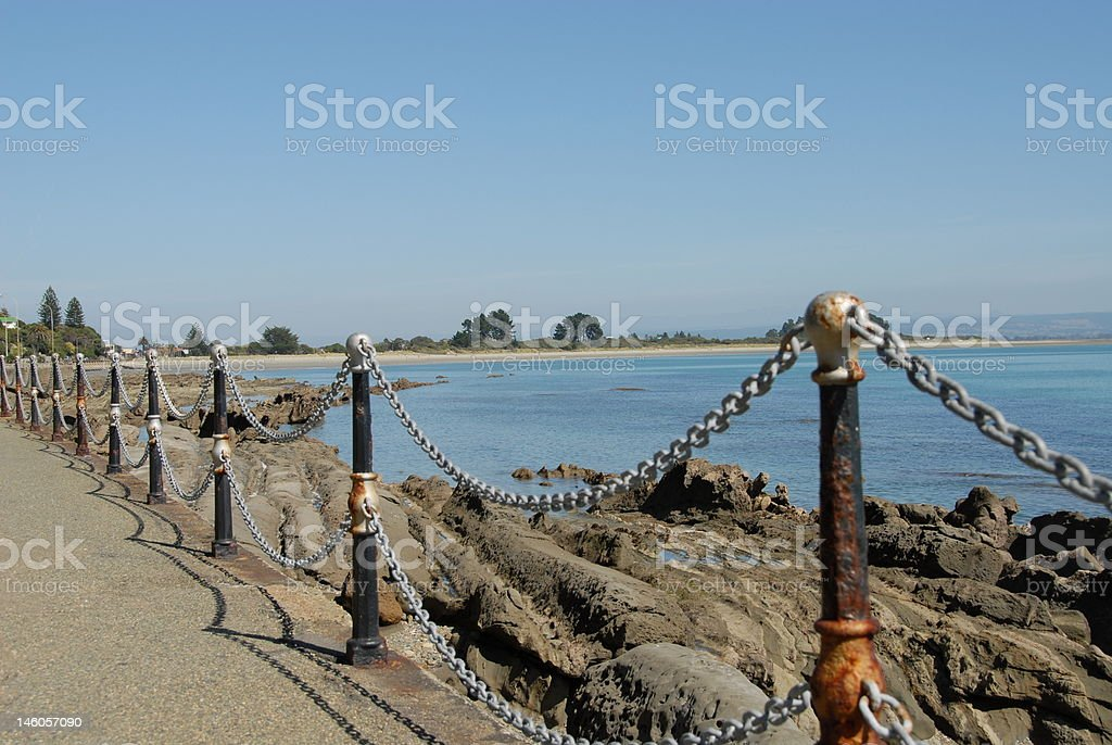Chain fence and beach setting stock photo