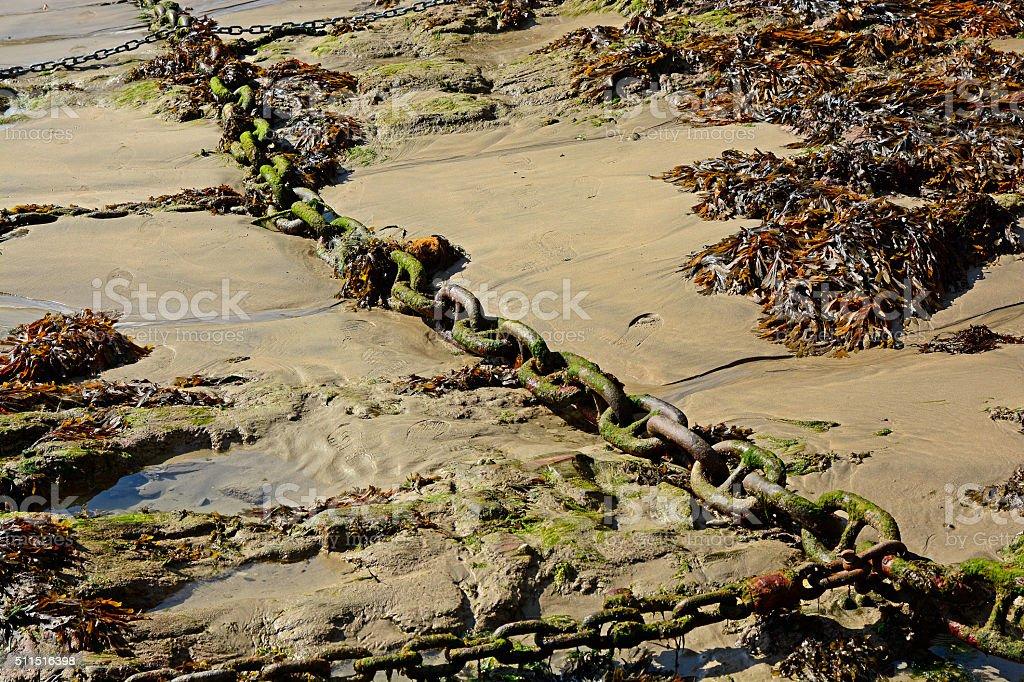 Chain for mooring on beach, Newquay, Cornwall, UK stock photo