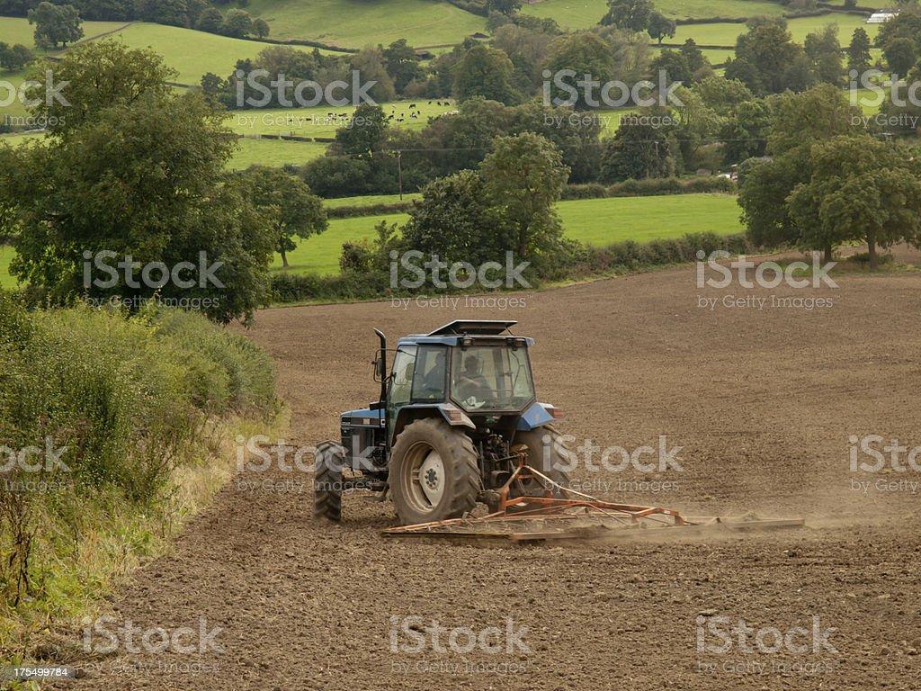Chain Harrowing a field stock photo