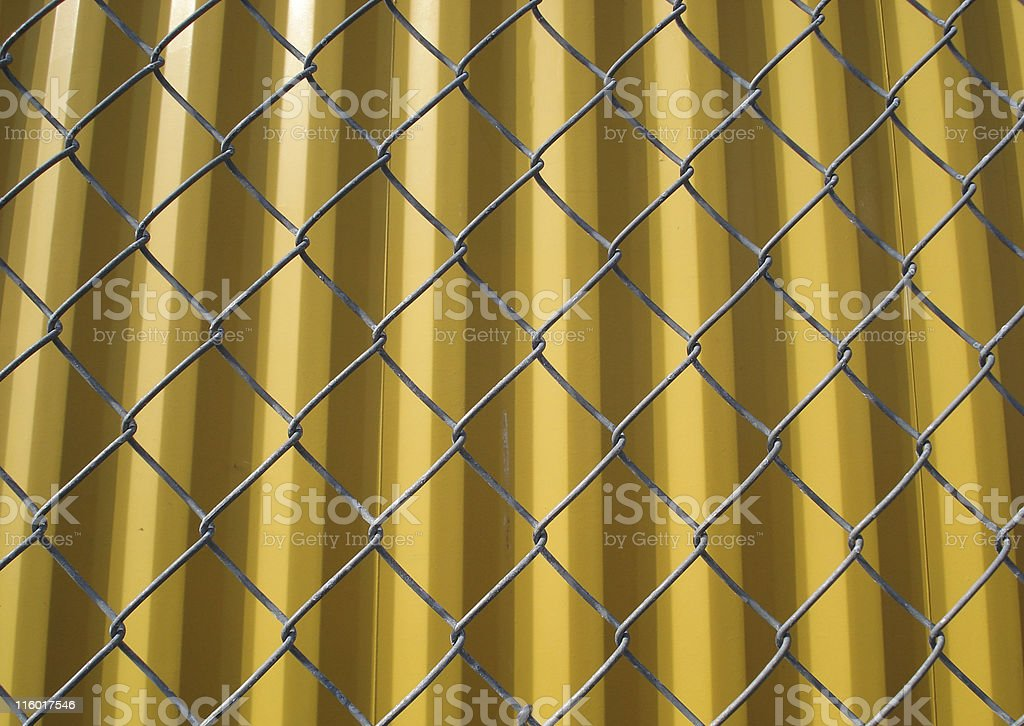 chain link fence with cargo container royalty-free stock photo