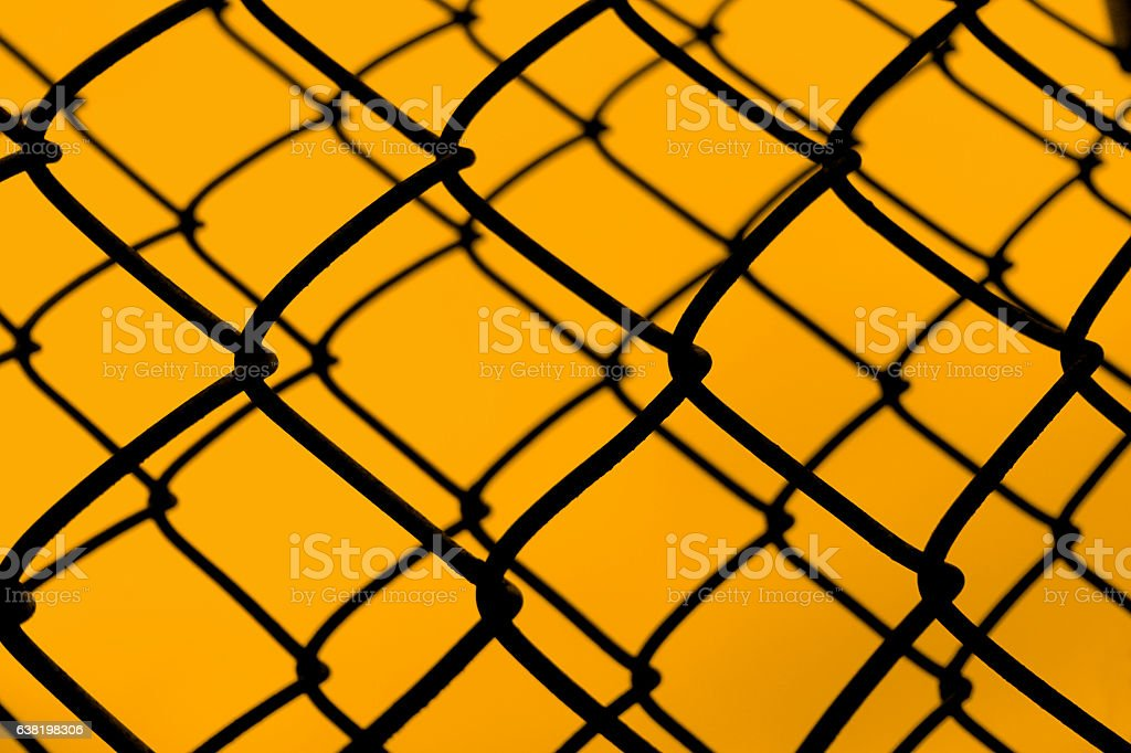 Chain Link Fence with Orange Background stock photo