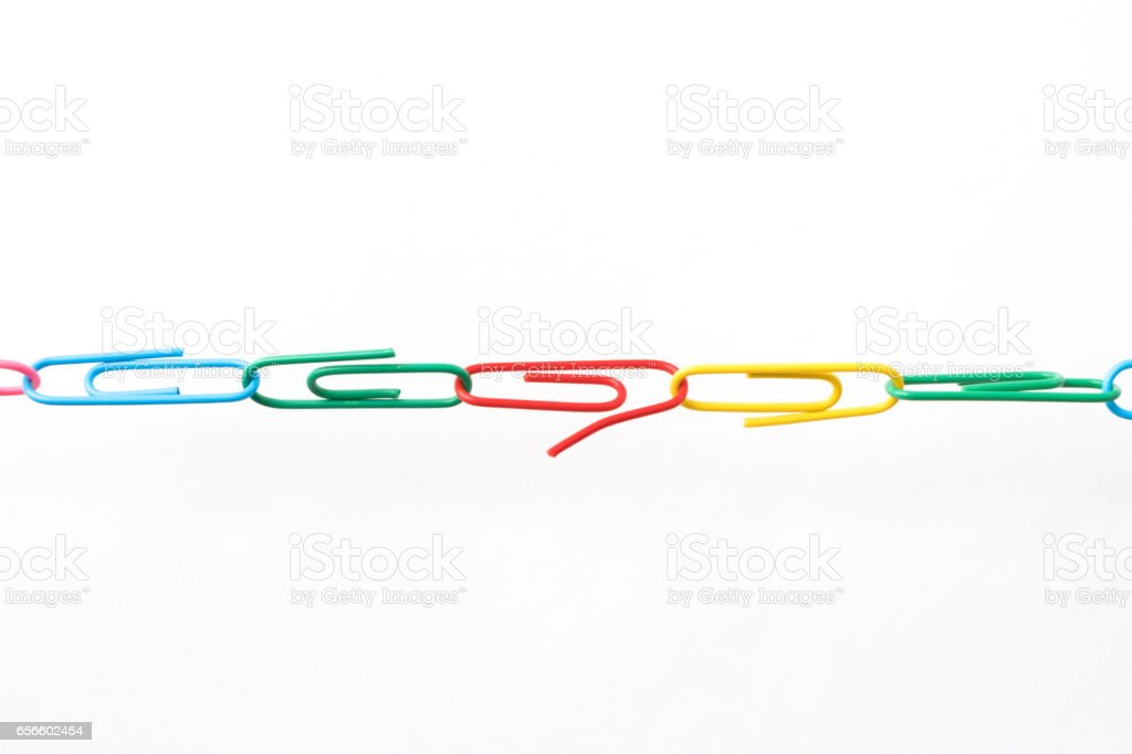 Chain made of paper clips meaning teamwork and cooperation stock photo