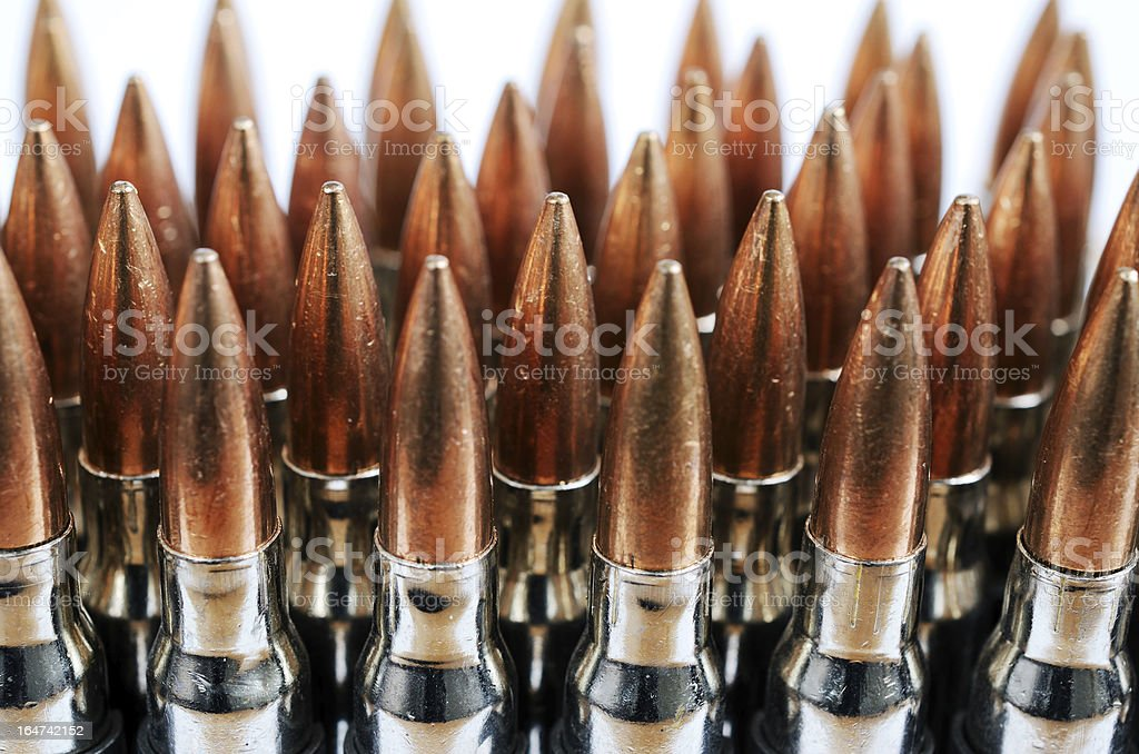 chain of bullets over white, closeup royalty-free stock photo