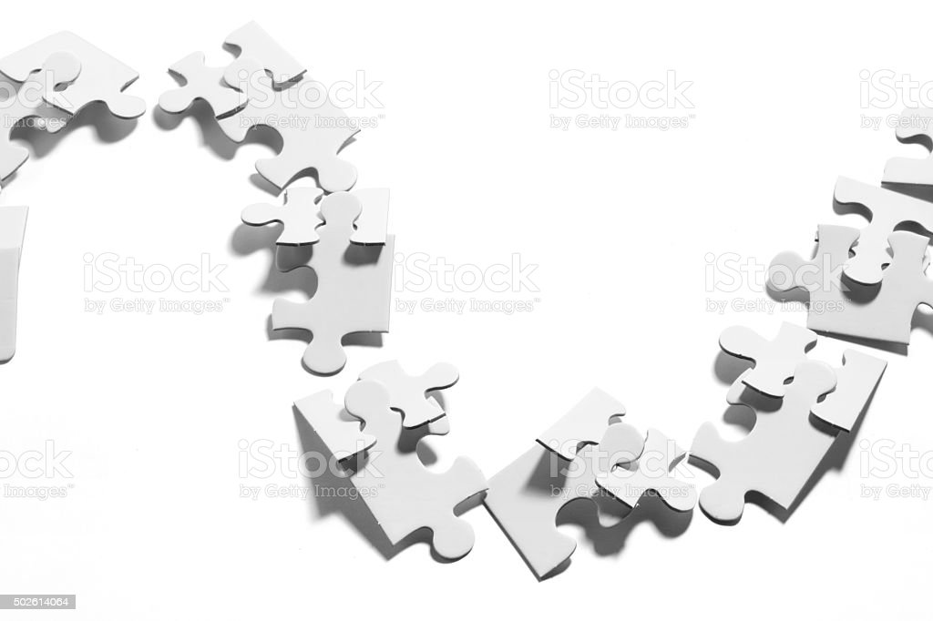 Chain of Jigsaw Puzzle Pieces stock photo