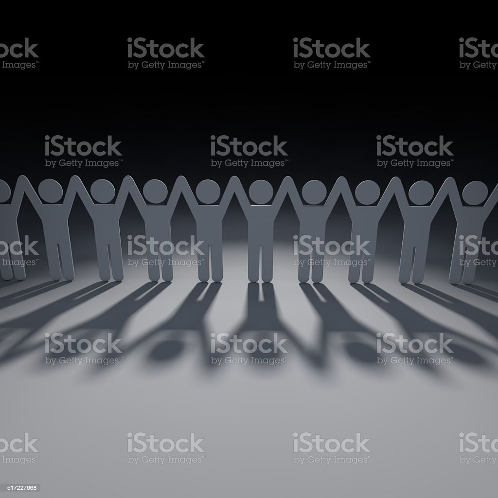 Chain of people holding hands above their heads stock photo