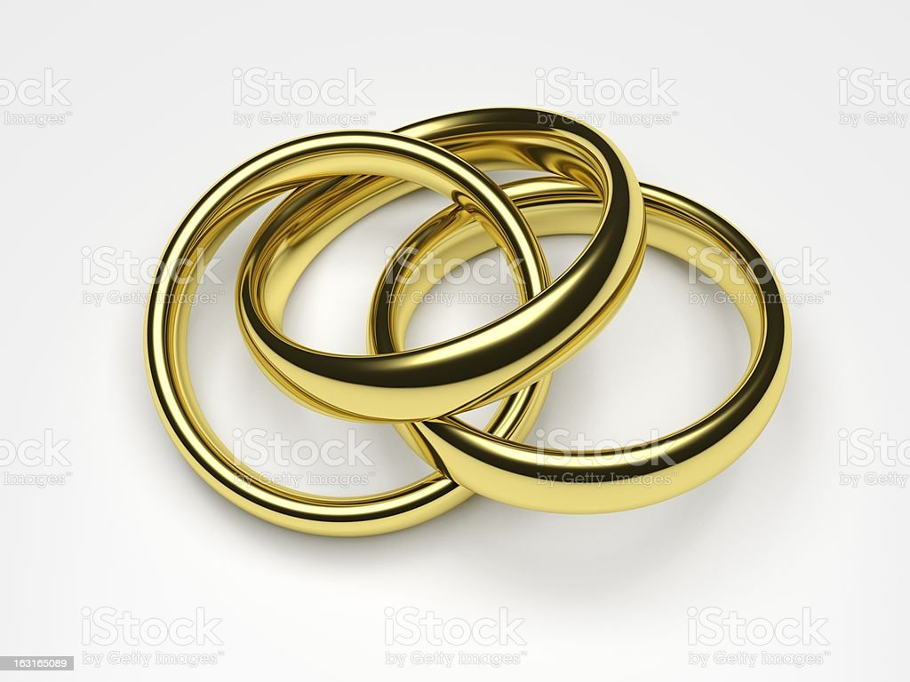 A chain of three golden rings, indicating polygamy royalty-free stock photo