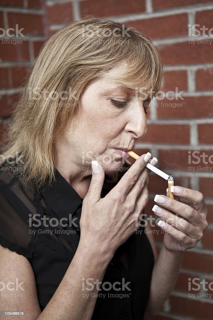 Chain Smoking stock photo