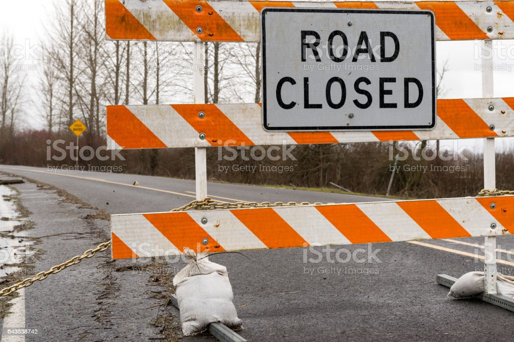 Chained Barricade Road Closed Sign in Road Flooded stock photo