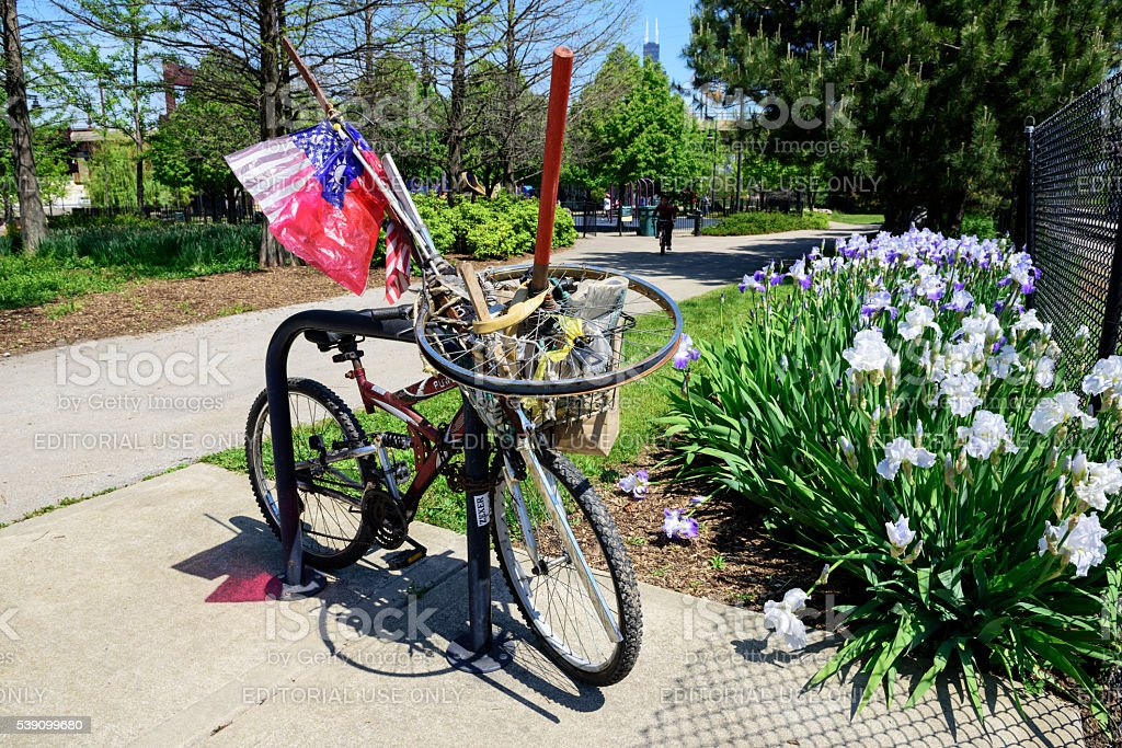 Chained bicycle and flags, Chicago Chinatown park stock photo