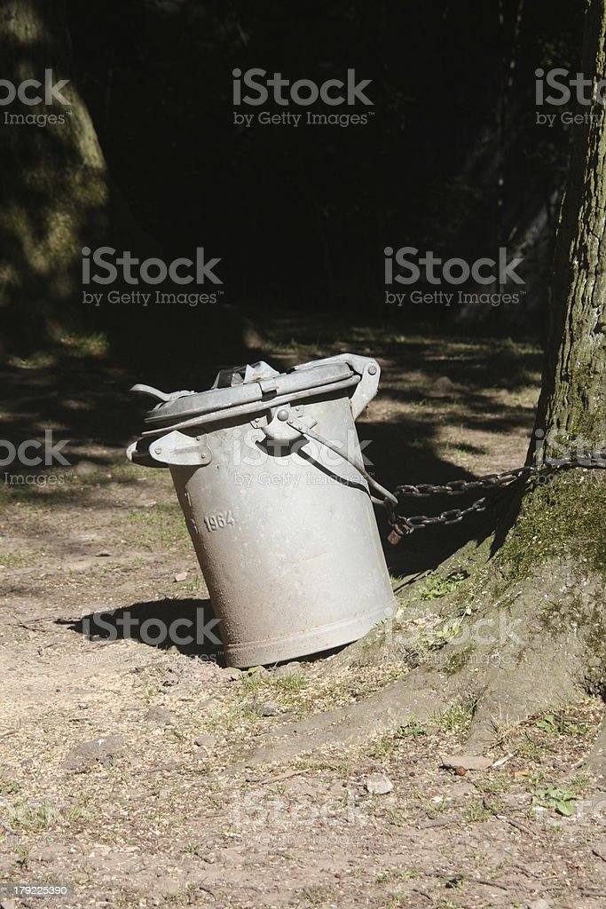 Chained dustbin stock photo