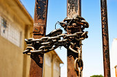 Chained gates of an abandoned factory in close up