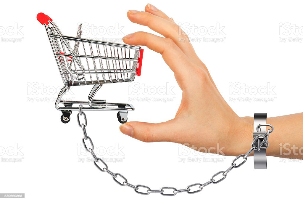 Chained hand holding shopping cart stock photo