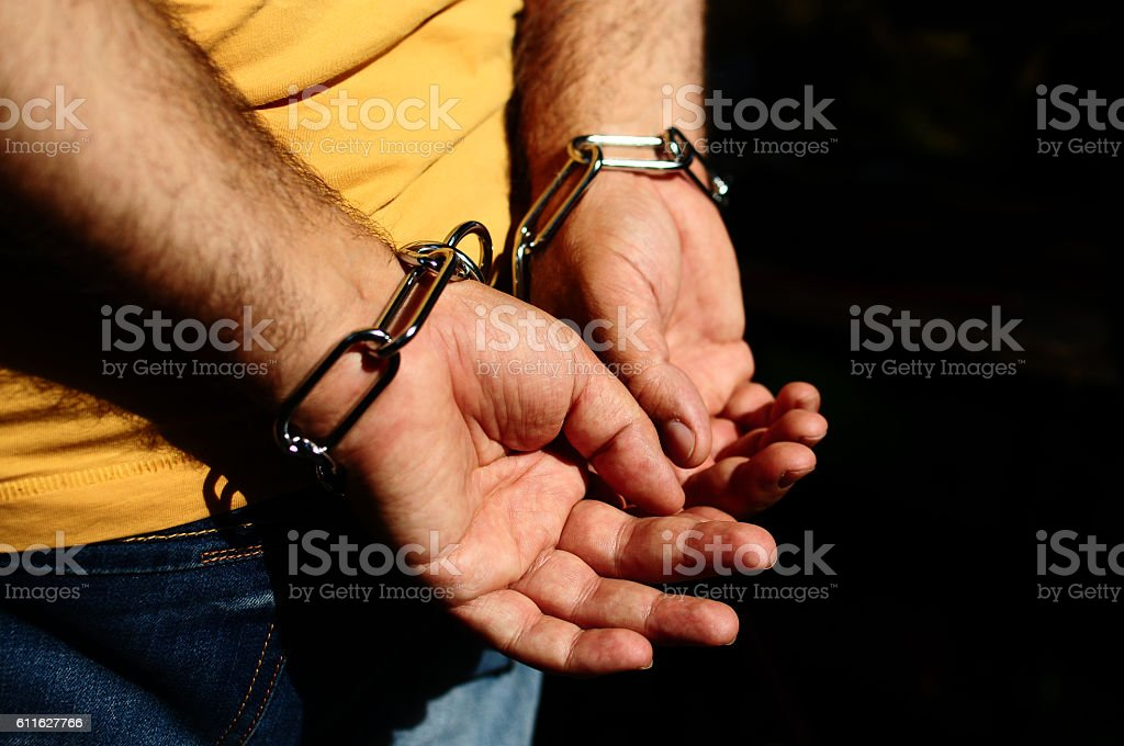 Chained human hands. stock photo