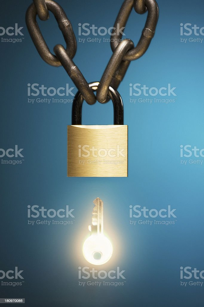 chained padlock isolated on blue background royalty-free stock photo