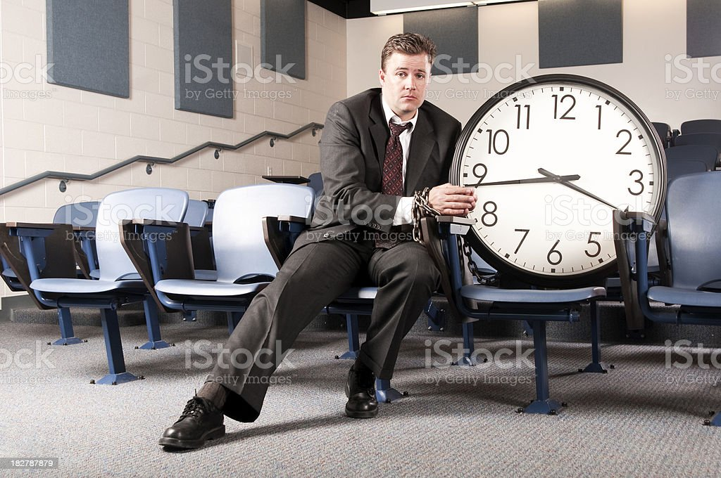 Chained to the clock stock photo