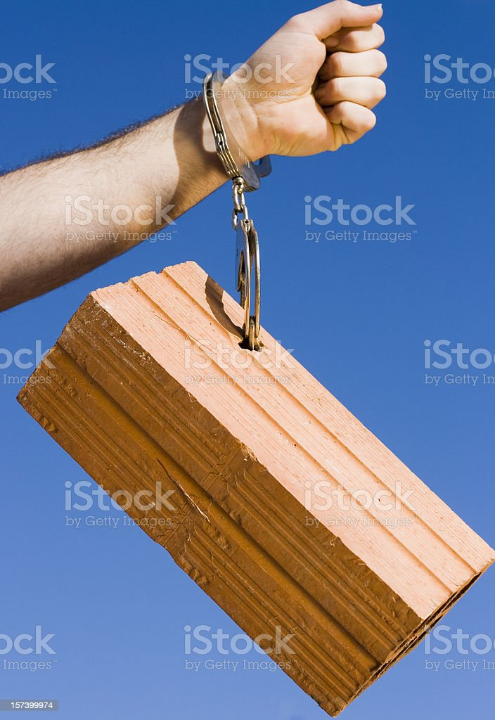 Chained to the housing stock photo