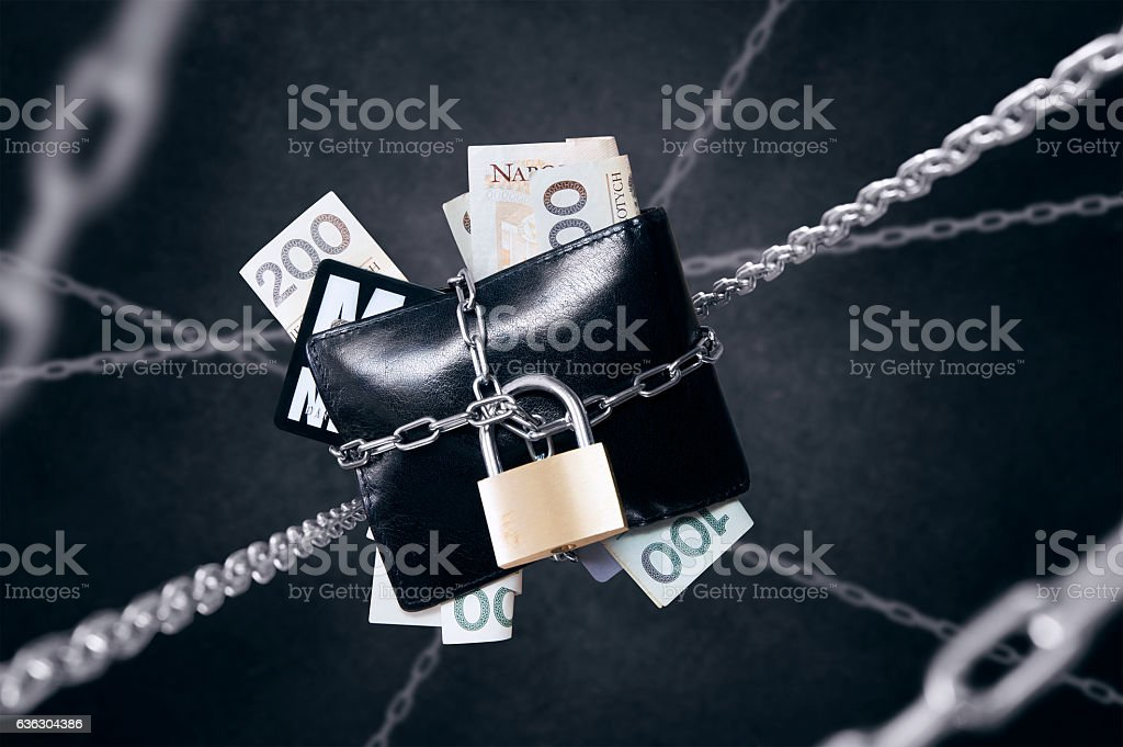 Chained wallet. Conception of finance security and protection stock photo