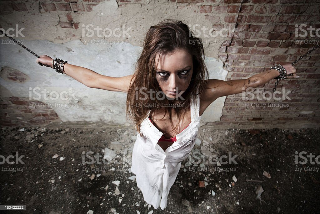 Chained woman in old baisement royalty-free stock photo