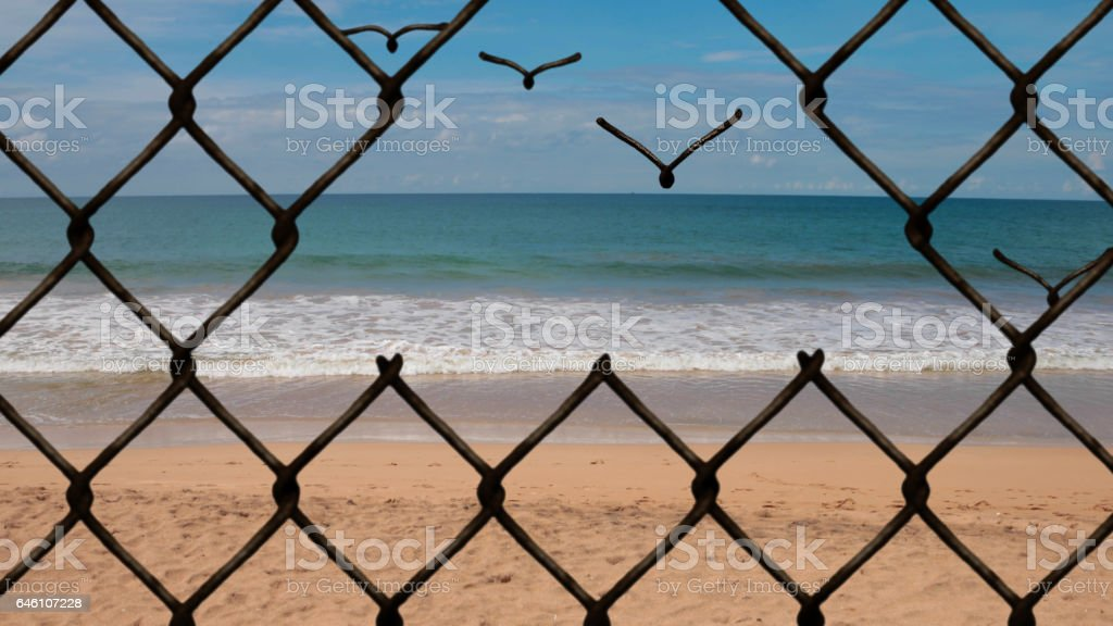 Chainlink fence breaking in to links and flying away to freedom stock photo