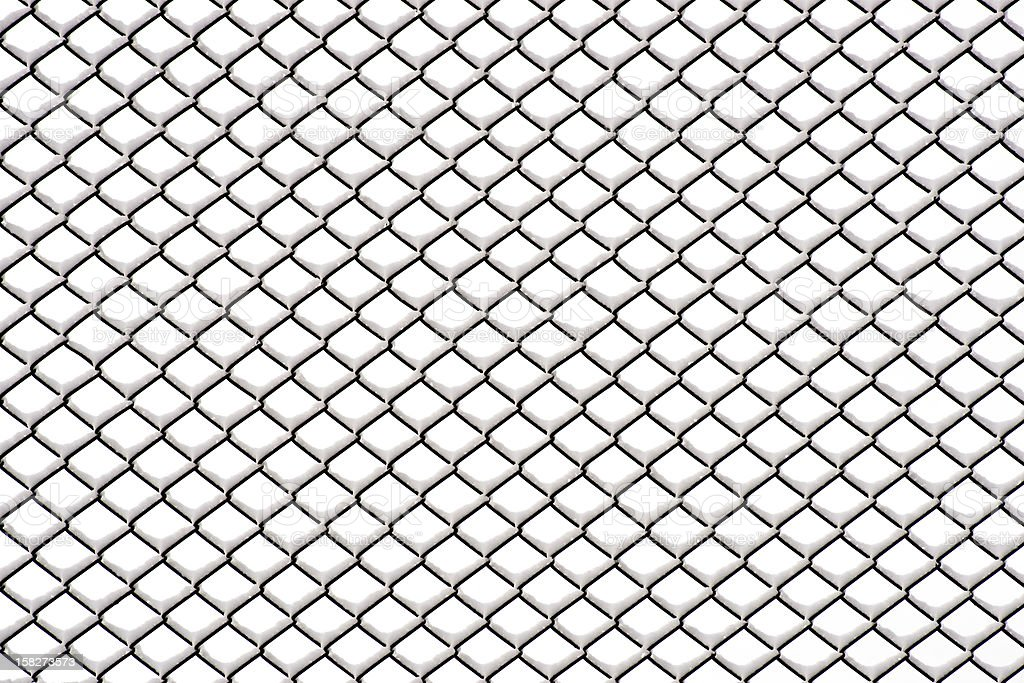 Chainlink fence with snow royalty-free stock photo