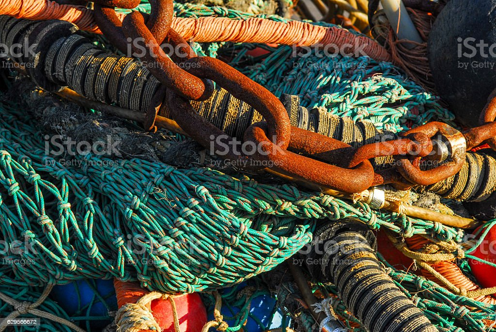 chains and fish trawl stock photo
