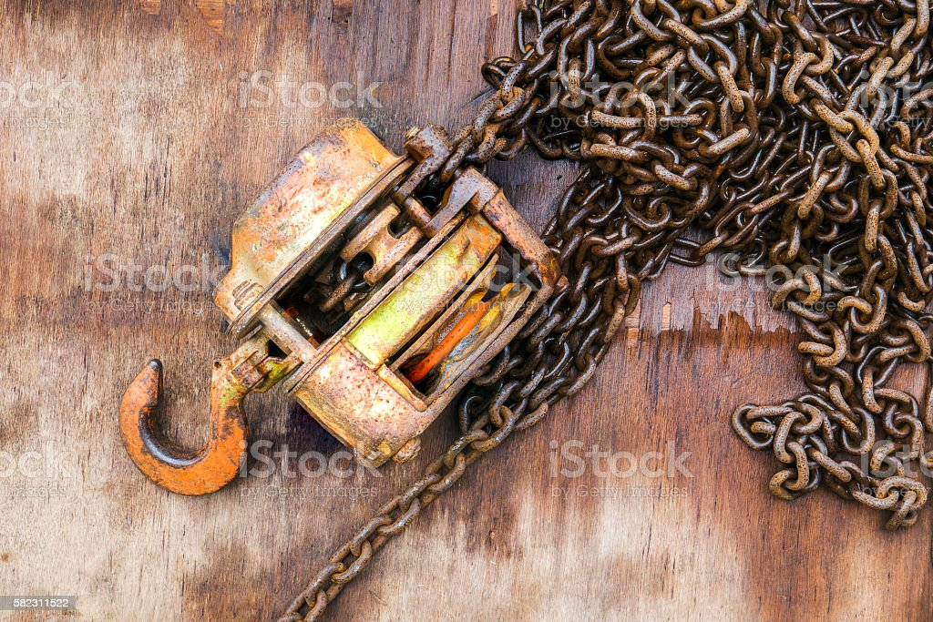 Chains and hooks on wooden background. stock photo