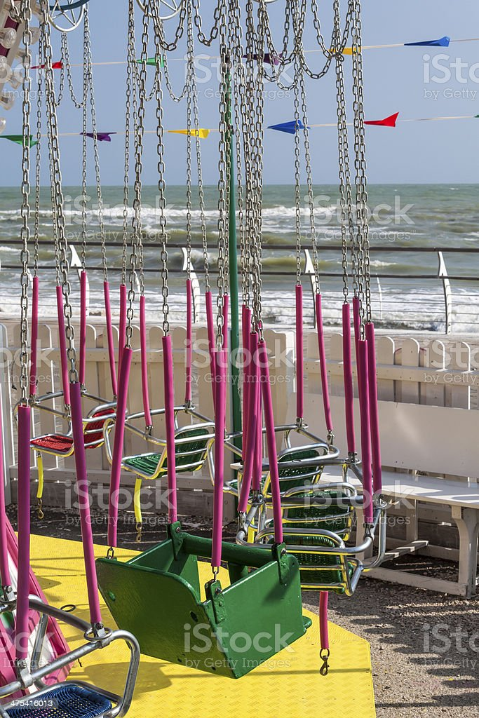 chains carousel at sea promenade stock photo