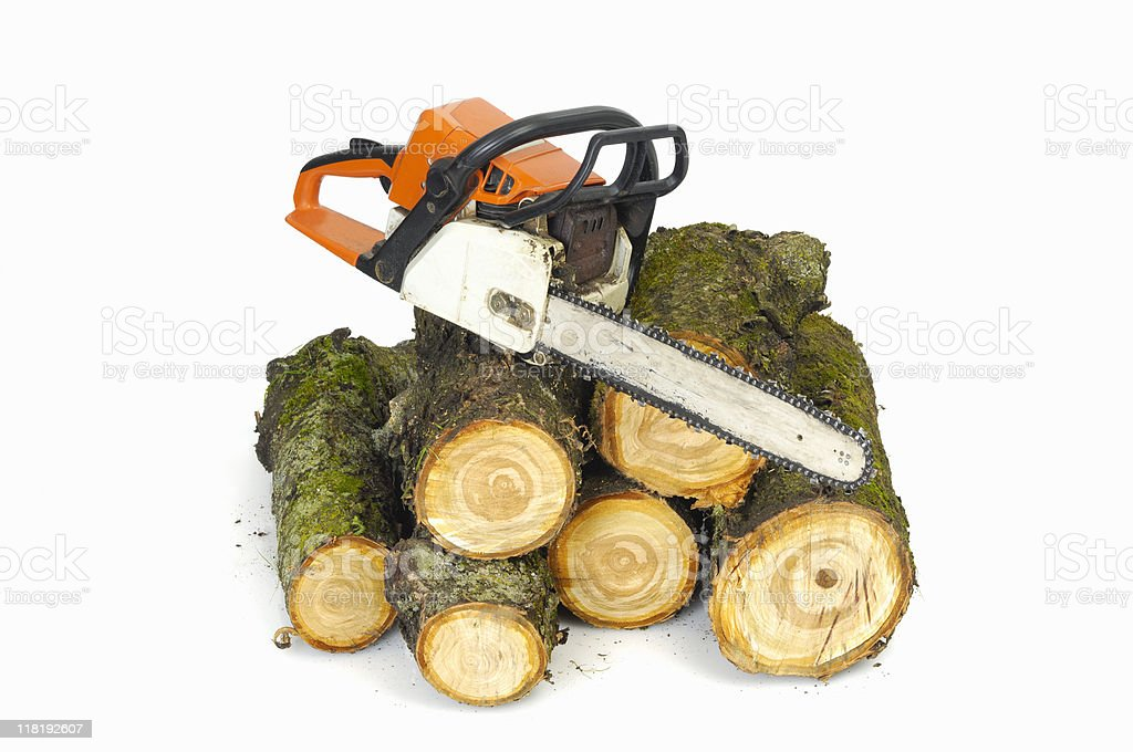 Chainsaw and logs on white royalty-free stock photo