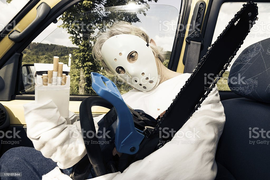 chainsaw murderer hitchhiking royalty-free stock photo
