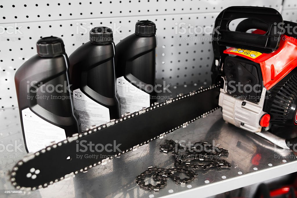 Chainsaw, oil bottle display on tool store stock photo