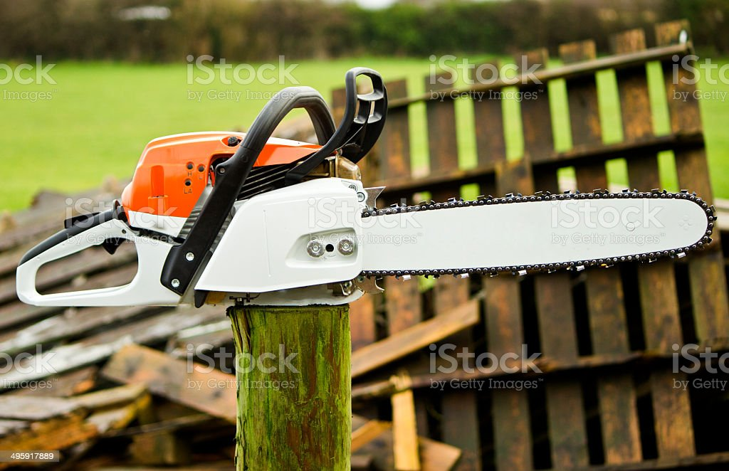 Chainsaw on a pole stock photo