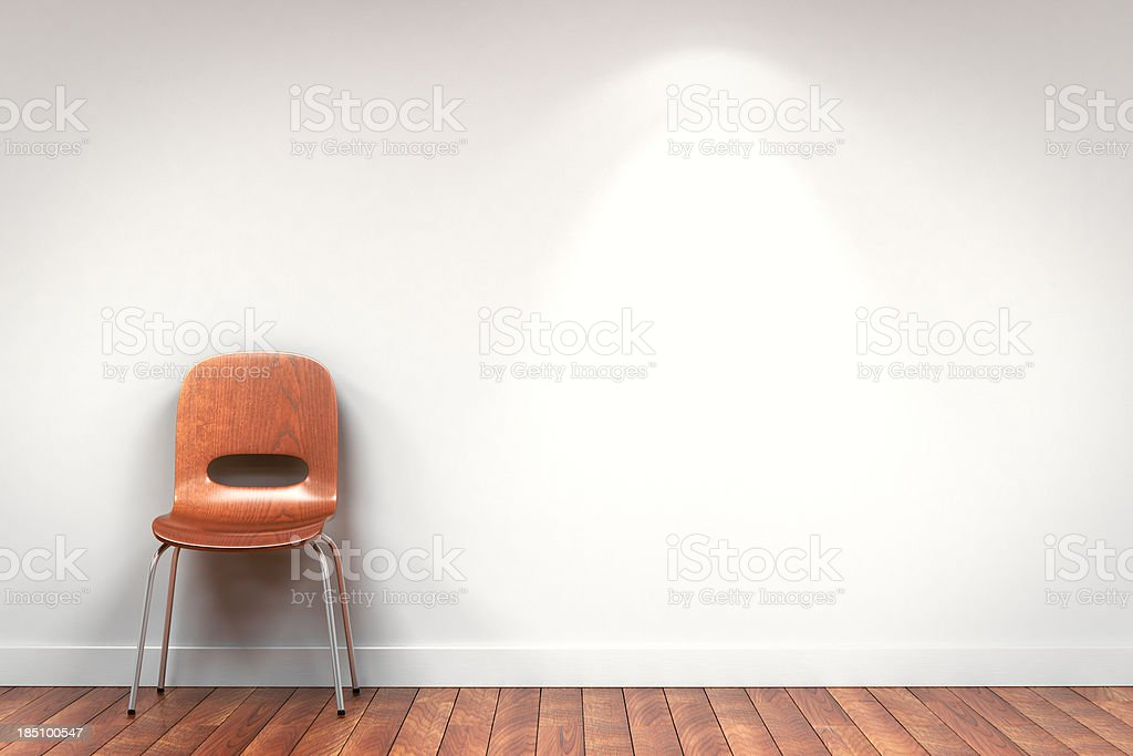 Chair against gallery wall with copyspace royalty-free stock photo