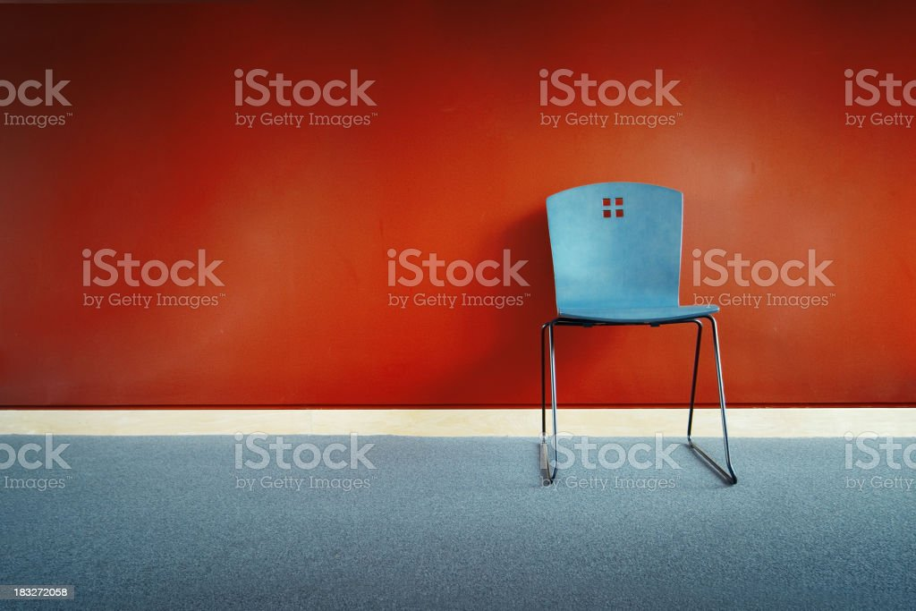 Chair against wall stock photo