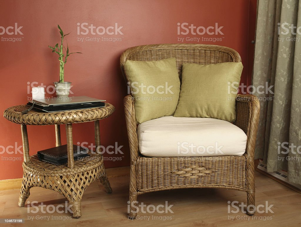 Chair and table made of wicker stock photo