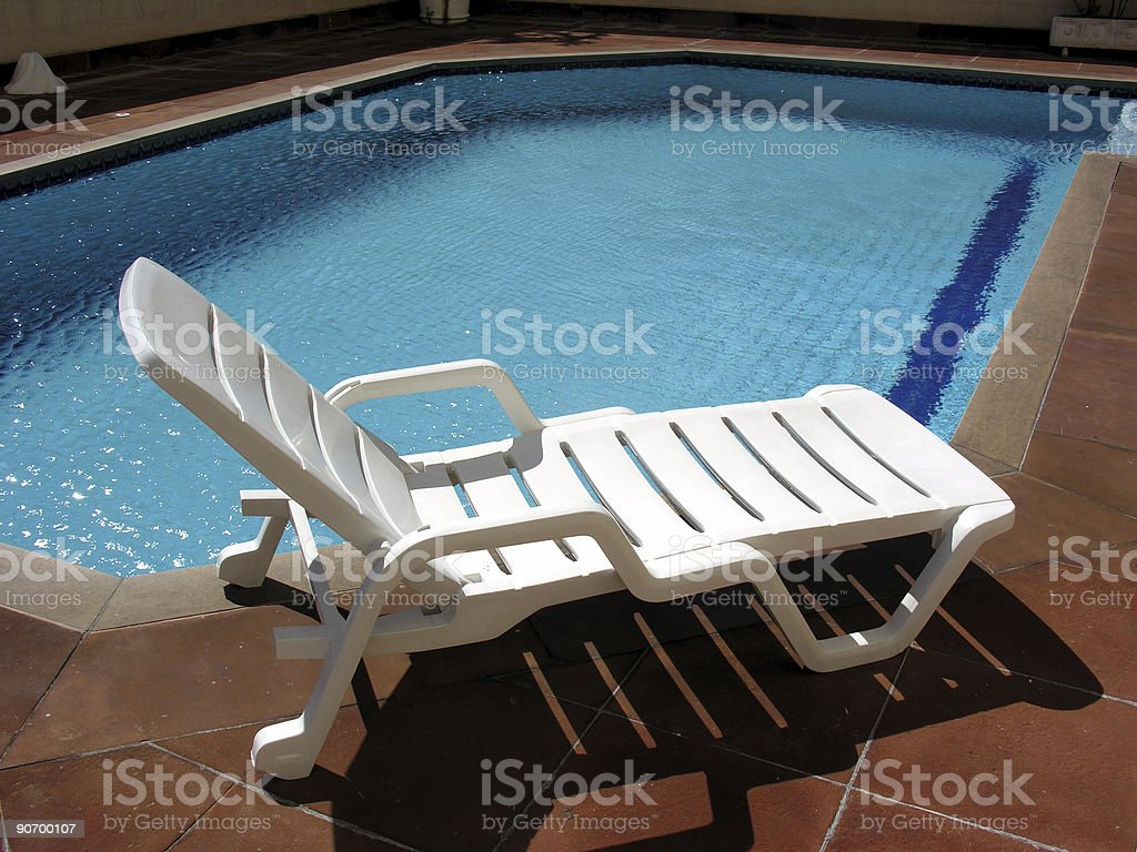 Chair at a pool 2 stock photo