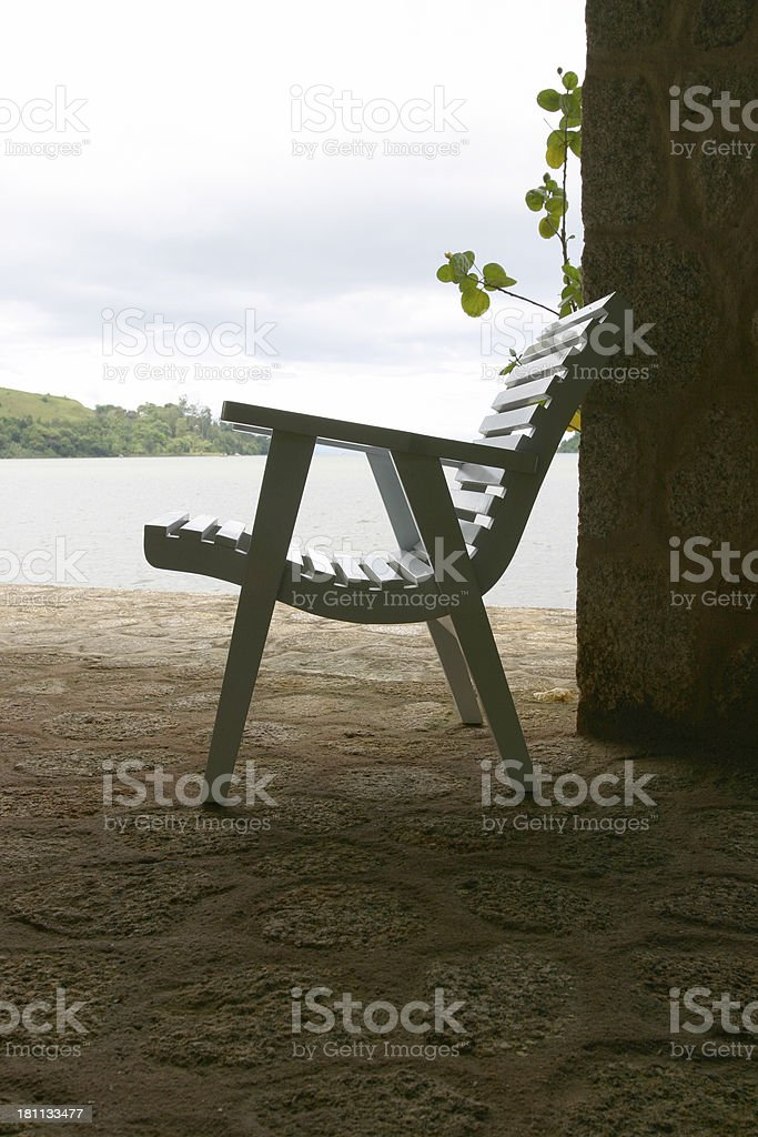Chair by the water royalty-free stock photo