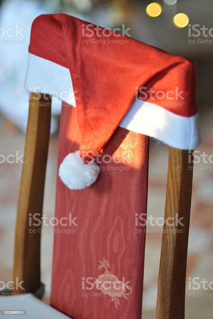 Chair dressed in Santa Claus Hat stock photo