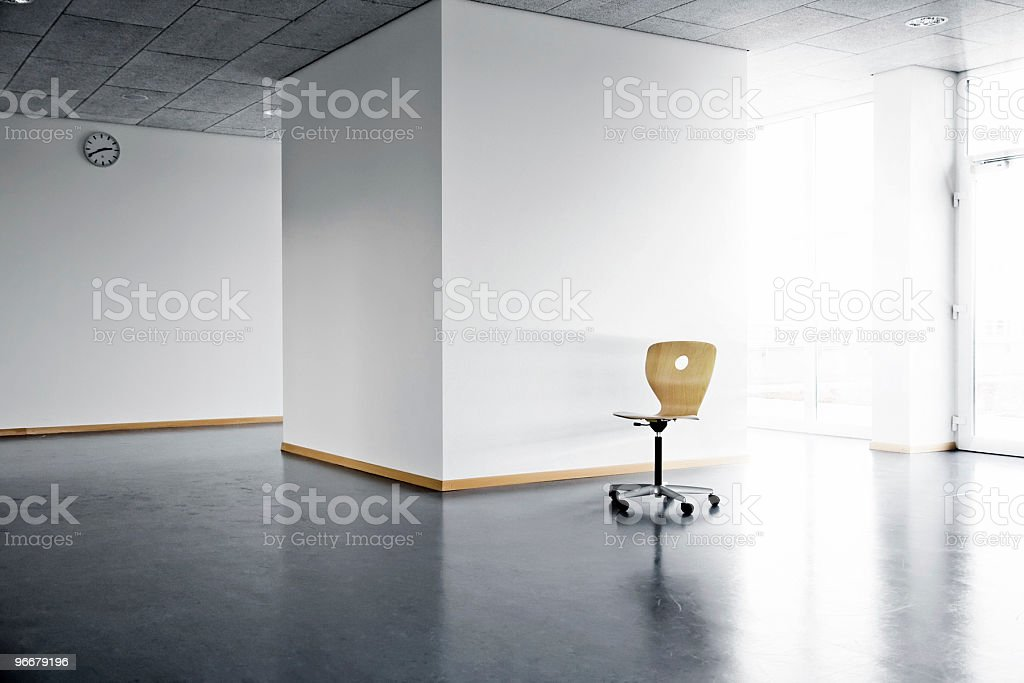 chair in empty room stock photo