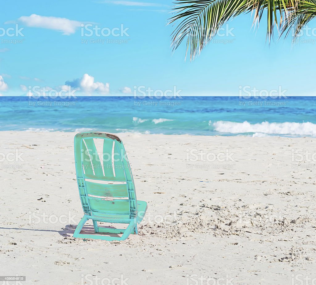 chair in the sand stock photo