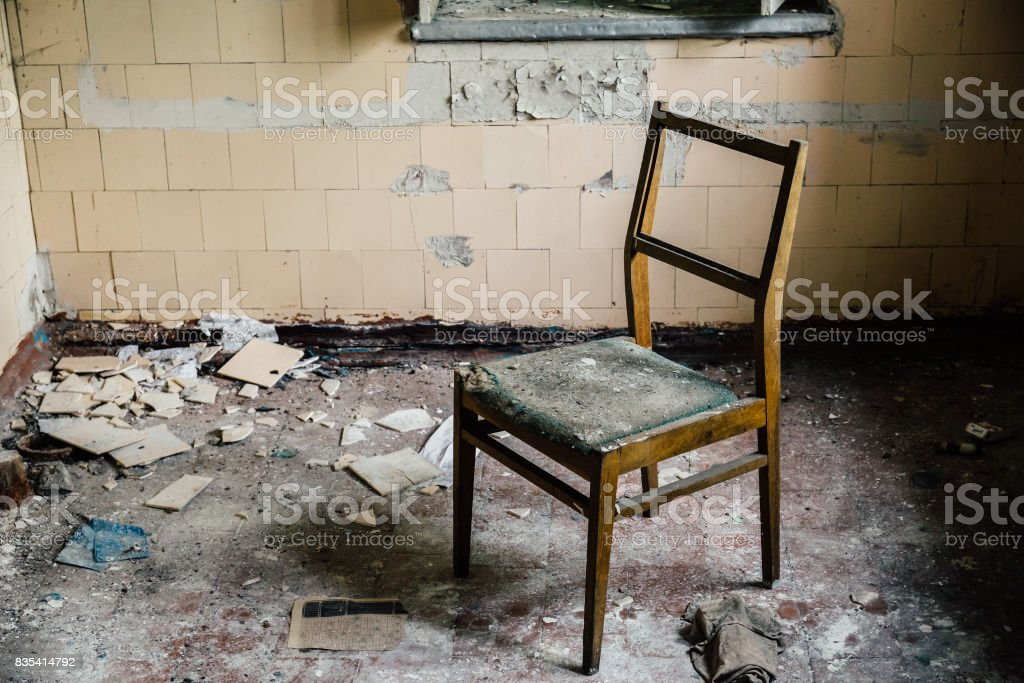 chair inside an old abandoned house stock photo