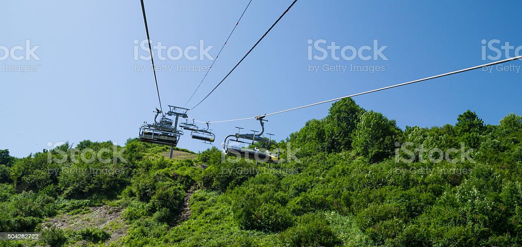 Chair lift above the mountains stock photo
