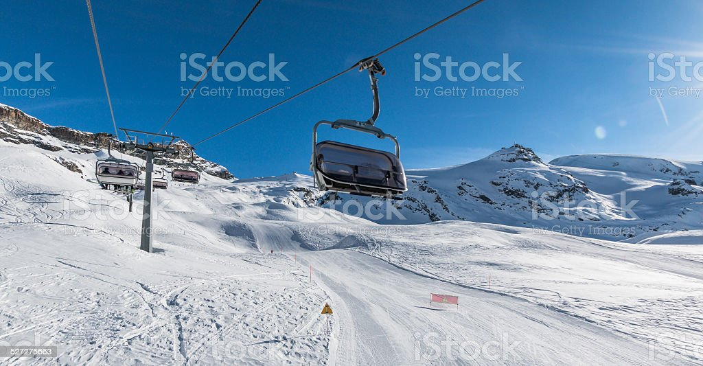 Chair lift and ski slope stock photo