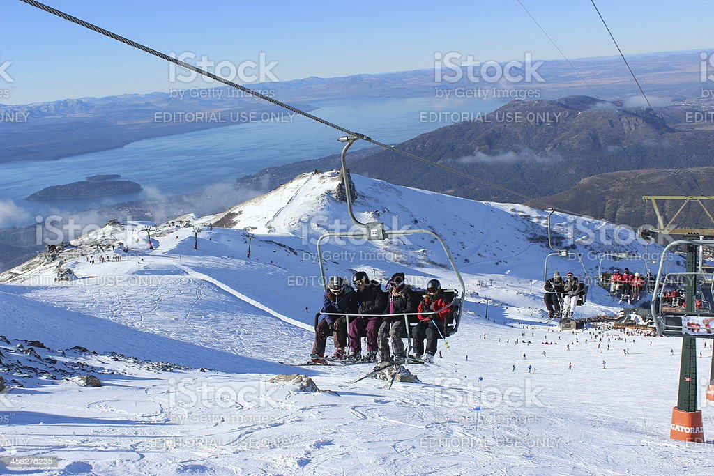 Chair lift at ski station CERRO CATEDRAL (background: Gutierrez Lake) stock photo