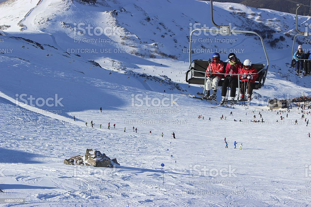 Chair lift going up on ski station CERRO CATEDRAL stock photo
