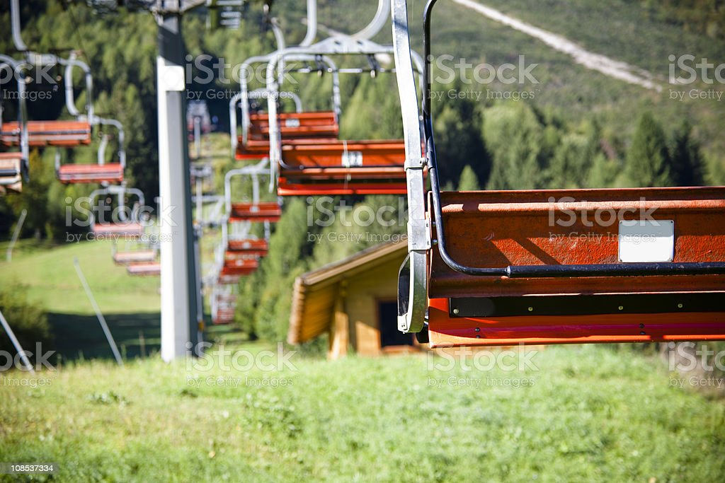 Chair lift in Alps mountain view stock photo