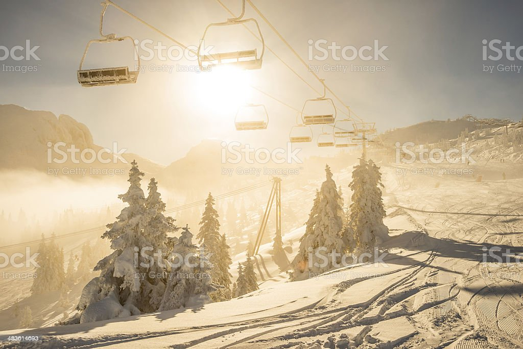 Chair lift in the sun stock photo
